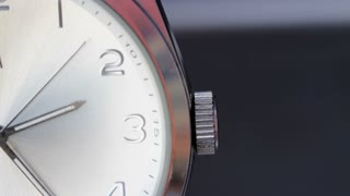 Close up shot of a white wrist watch and its seconds hand passing...