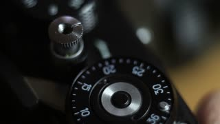 Close up shot of an old camera´s shutter button and a man pressing the shutter