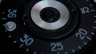 Close up shot of an old camera´s shutter button and a man pressing it