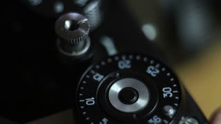 Close up shot of an old camera´s shutter button and a man pressing it...