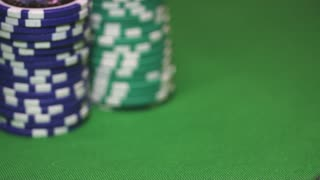 Close up view of Las Vegas casino chips - somebody pushing the chips to the front betting all in...