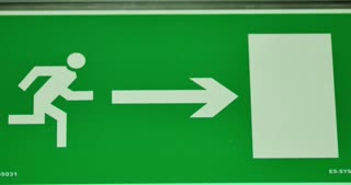 Emergency exit sign going out of focus and comes into focus again
