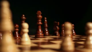 Footage of a chess board and it´s peaces on it and a person putting the white king next to the black king...