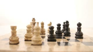 Footage of a chess board isolated on white background, the exchange, a pawn for a pawn...