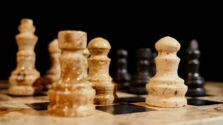 Footage of a chess game and a person performs the castling...