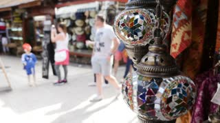 Footage of a colorful light lamp and some colorful carpets hanging in the old city of Sarajevo...