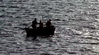 Footage of a couple of people fishing in a small boat...