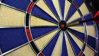 Footage of a dart board coming in and out of focus...
