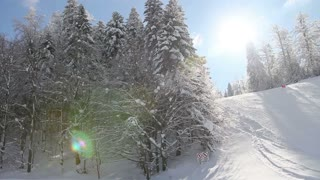 Footage of a winter scene, a ski slope at a mountain