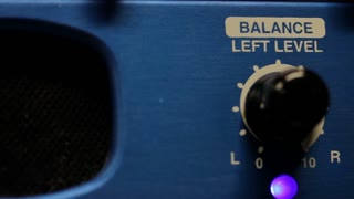 Footage of a hand adjusting the volume balance - left level...