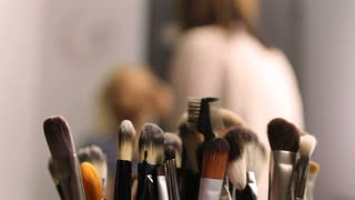 Footage Of A Make Up Artist Doing Professional Make Up The Brushes Lying In The Front And In Focus