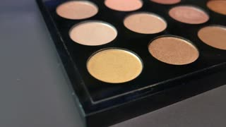 Footage of a make-up palette, the shot is moving from one side to the other and vice versa...