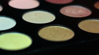 Footage of a make up palette, the shot is moving from one side to the other...
