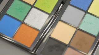 Footage of a make-up palette, the shot moves from the bottom to the top...