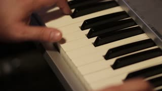 Footage of a man practicing on his piano...
