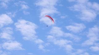 Footage of a paraglider enjoying the flight...