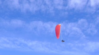 Footage of a paraglider landing...