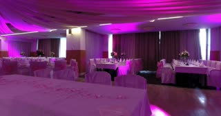 Footage of a pink-purple decorated restaurant waiting for the wedding guests...