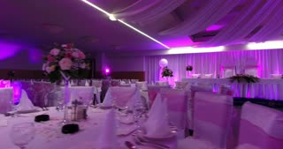 Footage of a pink-purple scene in a restaurant waiting for the nuptials...