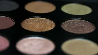 Footage of a professional make-up palette, the shot is moving...