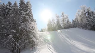 Footage of a skier skiing downhill slalom - the shot moves from the left to the right