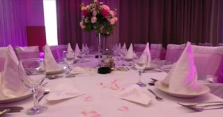 Footage of decorated chairs and tables in a restaurant ready to receive wedding guests...
