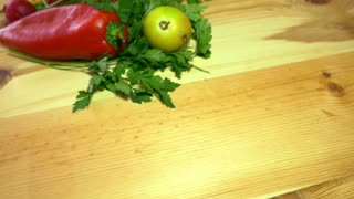 Footage of fresh organic vegetables on a wooden table, the shot is moving in a half circle...