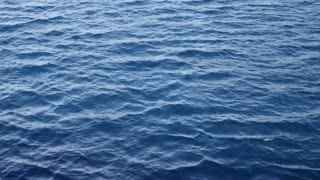 Footage of sea water, the shot is taken from a boat in motion...