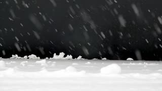 Footage of snow falling isolated on a black background...