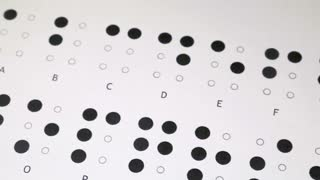 Footage of the Braille writing system alphabet, the shot is moving from left to right...