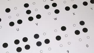 Footage of the Braille writing system alphabet, the shot is moving from right to left...