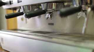 Footage of the coffee making process filmed in a restaurant with white cups...