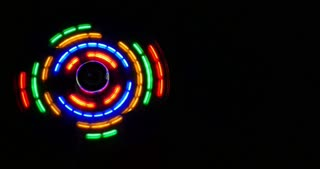 Front shot of a colorful cooling fan over a black background...
