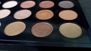 Front shot of a make up palette, the shot is moving from one side of the palette the the other and vice versa...
