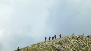 Group of people hiking in the mountains