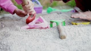 Kids playing with sand in a park
