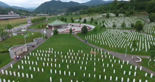 SREBRENICA, Potocari, Bosnia and Herzegovina - JUNE 19th: Memorial center in Potocari, the shot is moving showing the graves of the murdered men and boys of Srebrenica, on June 19, 2016 in Potočari, Bosnia&Herzegovina.