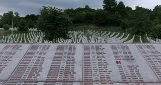 SREBRENICA, Potocari, Bosnia and Herzegovina - JUNE 19th: Memorial center in Potocari, the shot is moving showing the panel with the names of the murdered men and boys of Srebrenica, on June 19, 2016 in Potočari, Bosnia&Herzegovina.