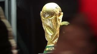 SARAJEVO, BOSNIA AND HERZEGOVINA - March, 2014: Close up footage of the world cup trophy and people posing next to it.
