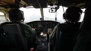 Shot of a helicopter pilot and a copilot in the helicopter cockpit heading to the place of accident...