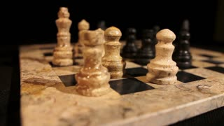 Side shot footage of a chess game and a person making the castling...