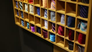 Side shot of a tie collection, the shot is moving from the bottom to the top...