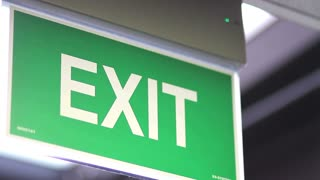 side shot of an emergency exit sign - it goes into focus and out of focus