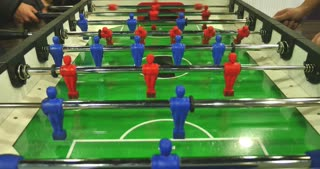 Some kids having fun by playing table football