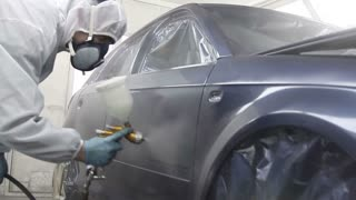 Spraying a car´s door...
