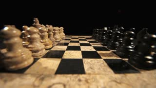 The start of a chess game, the opening move with a white pawn...