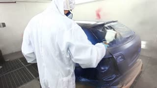 Time lapse of a car being varnished in a painting chamber...