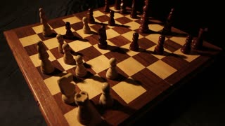 Time-lapse of a chess board and a chess game in progress...