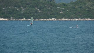 Two windsurfers enjoying the summer...