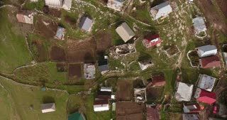 Vertical aerial footage of an old village high in the mountains...